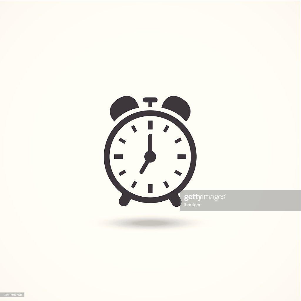 Black and white analog wind up alarm clock icon