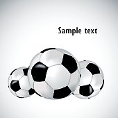 Black and white background with soccer balls