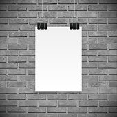 Black and white brick wall and paper poster for text, backgrpund mock up. Realistic black paper clamp. For Your business project. Vector Illustration