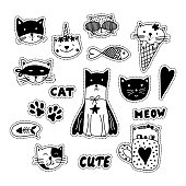 Black and white doodle stikers with cats, hearts, fish and paws.