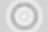Black and white dotted halftone vector background. Centered dotted gradient effect.