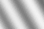 Black and white dotted halftone vector background. Faded radial dotted gradient.