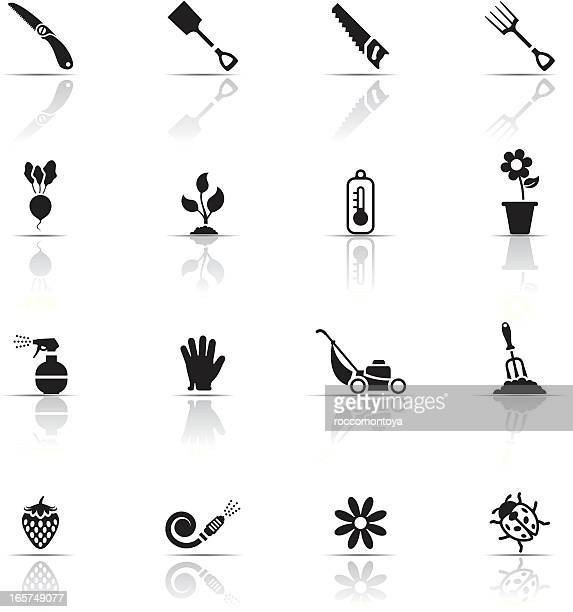 black and white icon set of gardening related items - garden fork stock illustrations