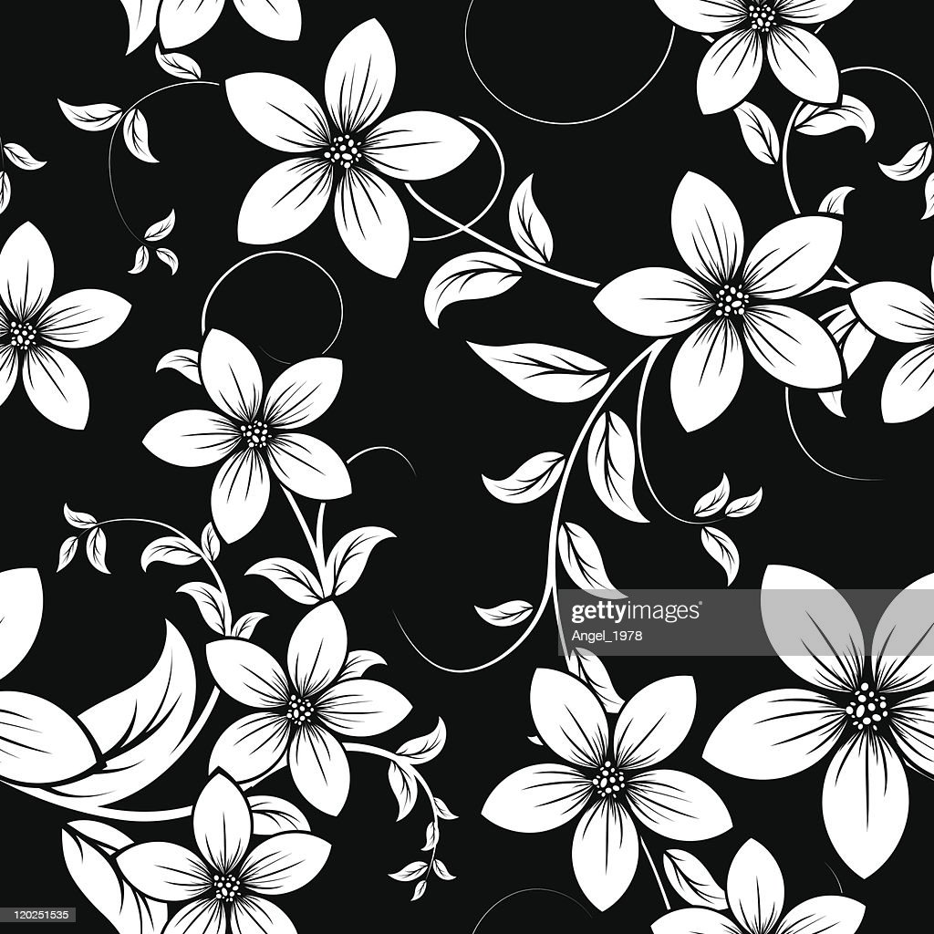 A black and white image of a floral pattern