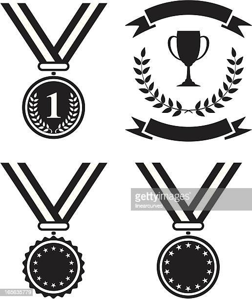 Black and white medals and a trophy