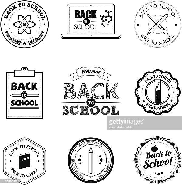 Black and white school badges
