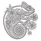 Black and white vector illustration with a chameleon in ethnic