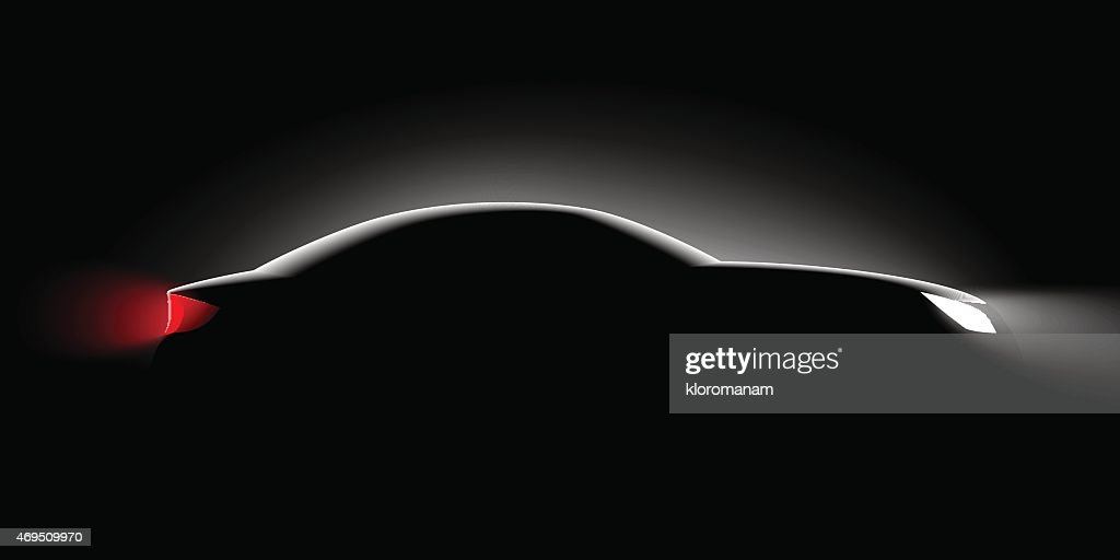 Black background and side view of a car only showing lights
