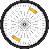 Black bicycle wheel with silver spokes and orange reflectors