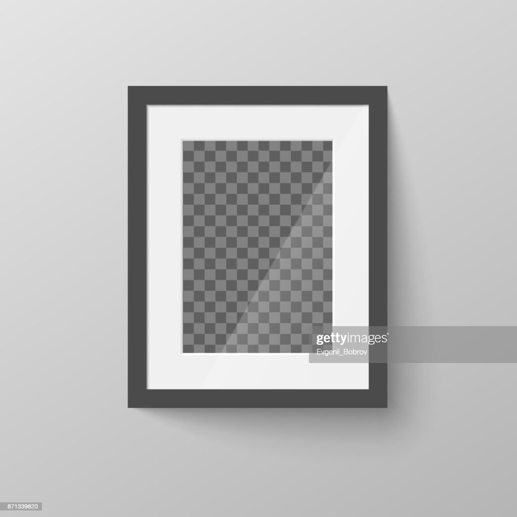 Black blank picture frame with transparent place for photo on gray wall