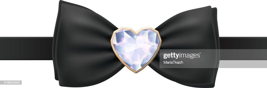 Black bow tie with heart diamond brooch.