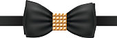 Black bow tie with square golden rivets brooch.