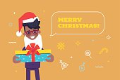 Black businessman in santa hat giving gift