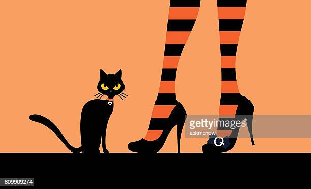 Black cat and witch's legs