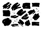 Black dry brushstrokes hand drawn set. Grunge smears vector collection.