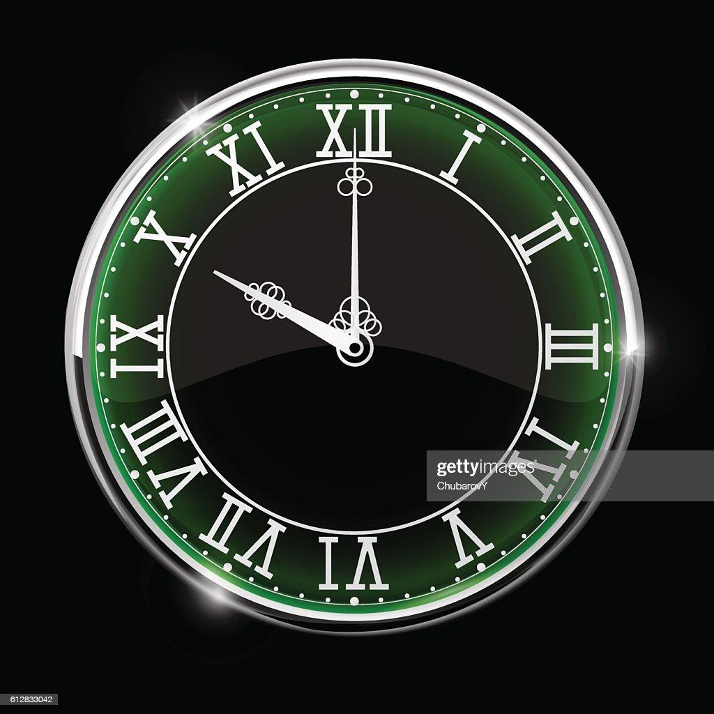 Black elegant clock with green backlight. Roman numerals