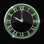 Black elegant clock with green backlight. Roman numerals