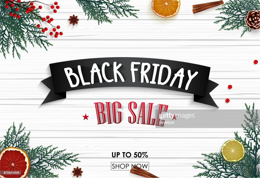 Black friday sale banner with christmas decoration on wooden background