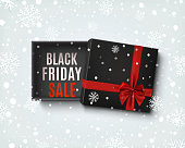 Black Friday sale design. Opened black gift box with red bow.