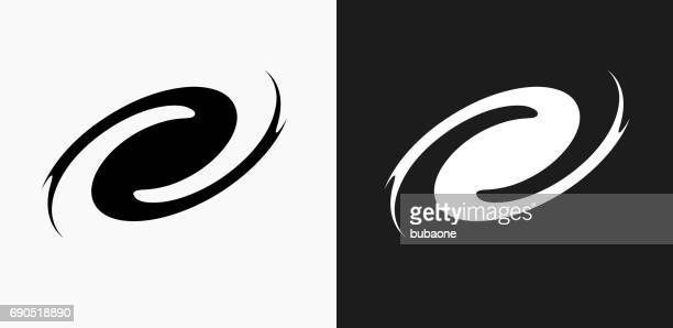 black hole icon on black and white vector backgrounds - black hole stock illustrations