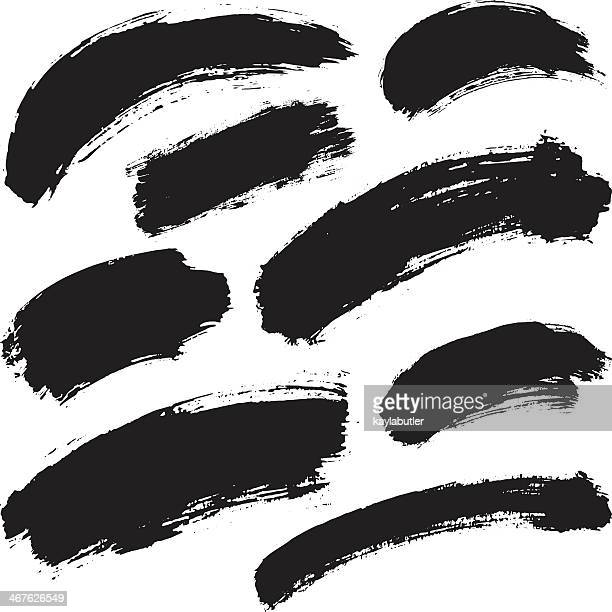 Black ink strokes on a white background