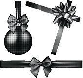 Black isolated Christmas ball and bow.