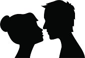 Black on white silhouette of man and woman about to kiss
