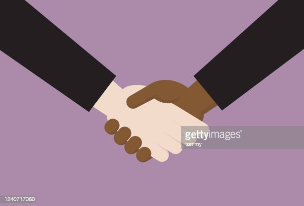 black person handshake with a white person - activist icon stock illustrations