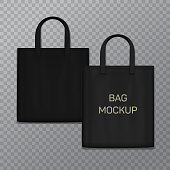 Black realistic shoping bag template isolated on background. Vector textile handbag.