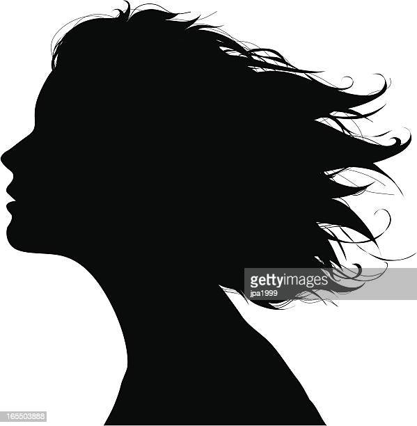 Black silhouette of a woman's facial profile in the wind