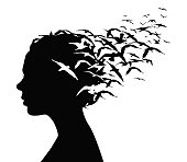 Black silhouette portrait of a pretty girl with birds flying from her head - thoughts, emotions or psychology concept.