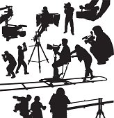 Black silhouettes of cameramen and camcorders