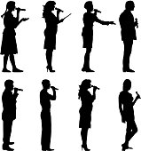 Black silhouettes of  mans and womans singing karaoke