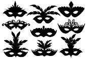 Black silhouettes. Set of carnival face masks. Masks for party decoration or masquerade. Mask with feathers. Vector illustration isolated on white background. Web site page and mobile app design