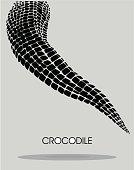 Black stylised crocodile tail on gray background