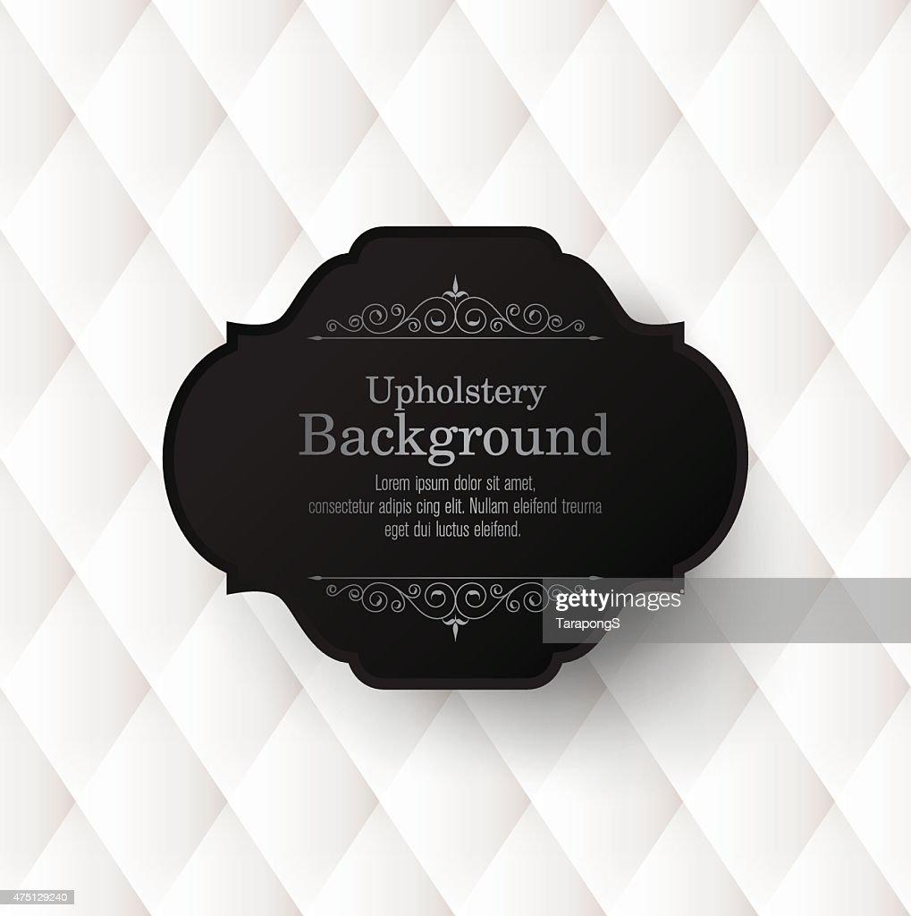 Black vintage frame on white upholstery background.