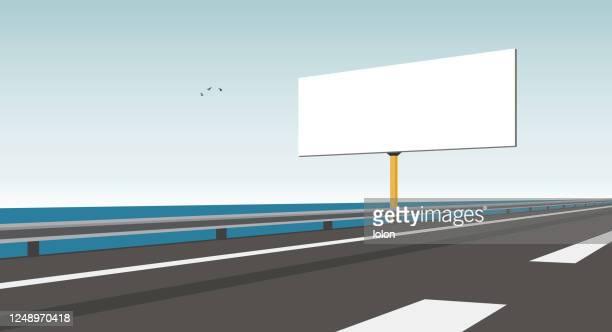 leere plakatwand und küstenautobahn - vektor-illustration - leitplanke stock-grafiken, -clipart, -cartoons und -symbole