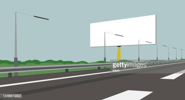 leere plakatwand und autobahn - vektor-illustration - leitplanke stock-grafiken, -clipart, -cartoons und -symbole