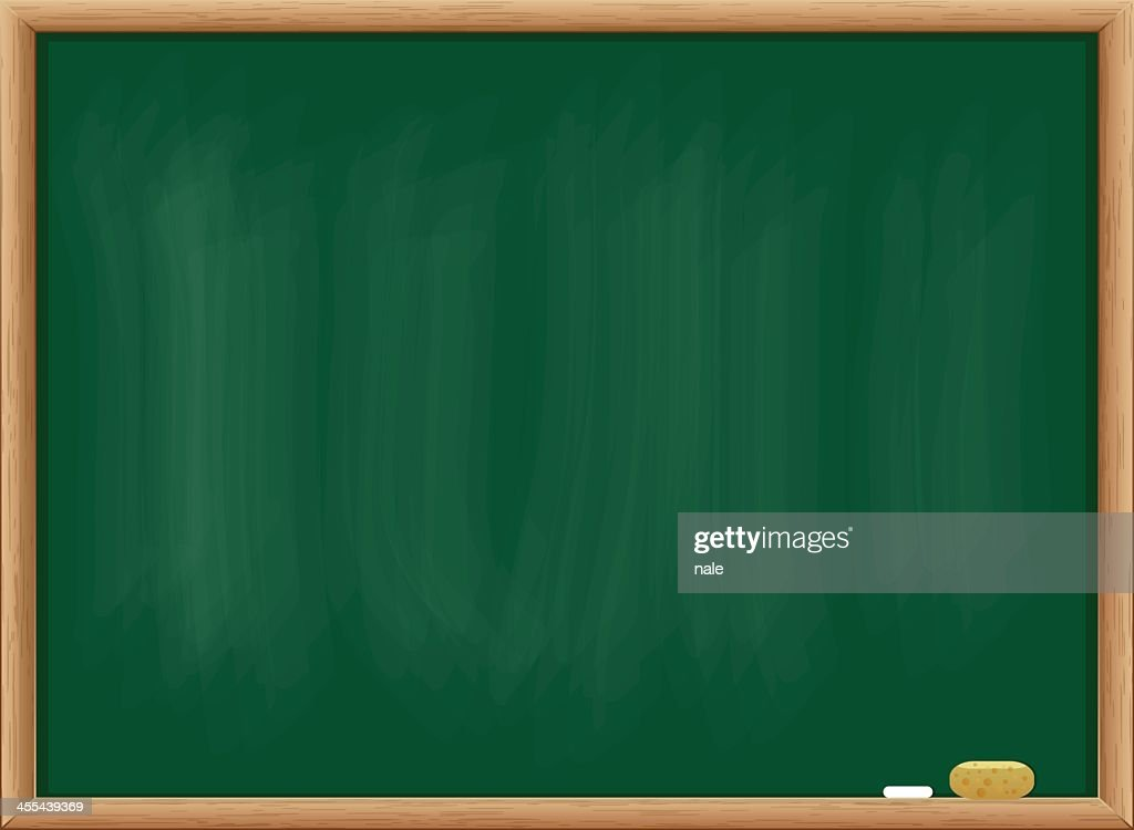 Blank blackboard with chalk and duster