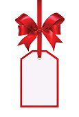 Blank gift tag with a red ribbon bow