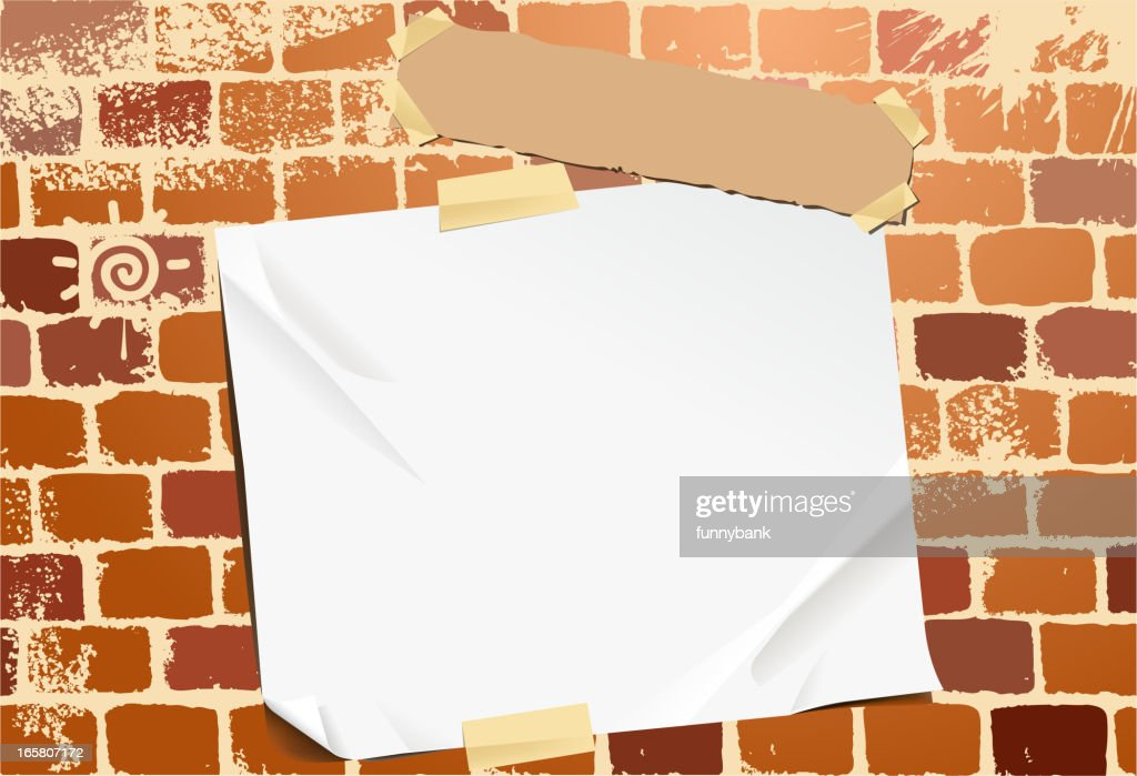 blank paper on stone wall