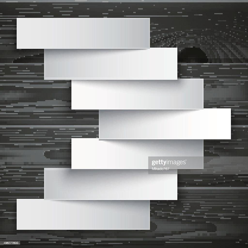 Blank paper stripe banners arrow on dark grey wood texture