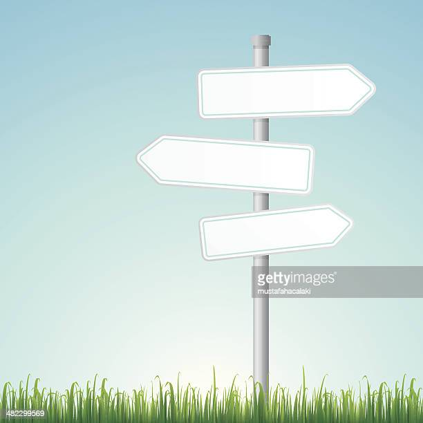 blank road signs with grass - directional sign stock illustrations