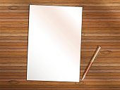 Blank sheet of paper with pen on wooden table