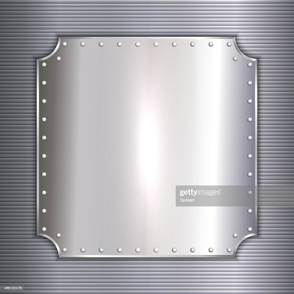 Blank silver metal plate bolted to corrugated wall
