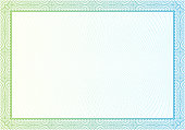 Blank white certificate with patterned green and blue border