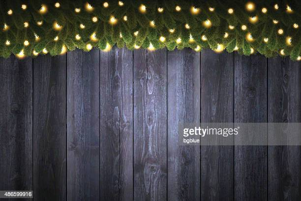 Blank Wooden Background with bright Christmas garland - vertical