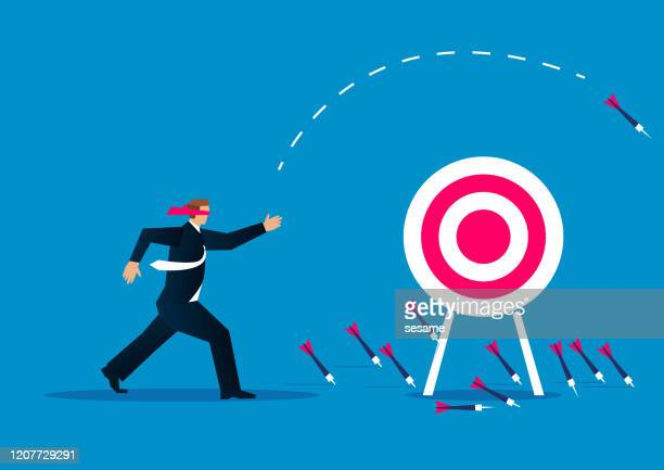 blind, businessman blindfolded throwing darts at target - dart stock illustrations