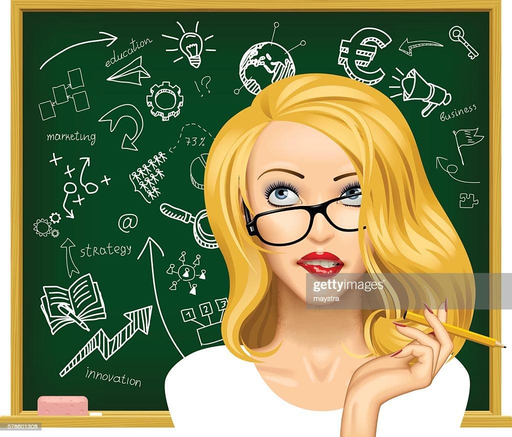 Blonde business woman in glasses near the blackboard