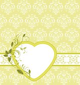 Blooming sprig with heart on the ornamental background